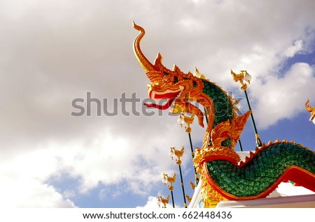 Naga statue in Thai temple, blue background