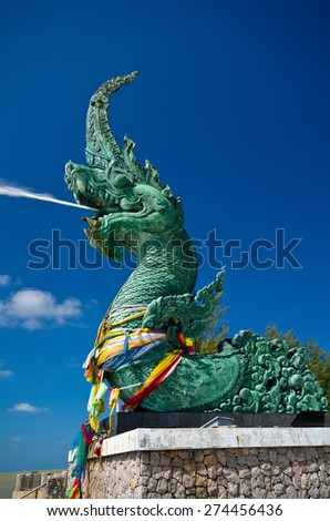Naga Statue The head great parent NAK statue spray water at Songkhla Thailand - stock photo