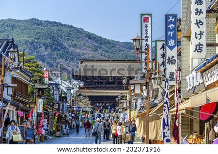 NAGANO,JAPAN - 23 April,2014 :The street approach to Zenkoji temple is lined with shops selling local specialties and souvenirs, as well as small restaurants. - stock photo