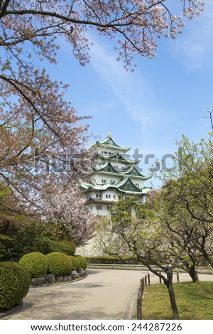 Nagoya Castle in Japan during cherry blossom season in spring. - stock photo