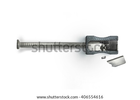 Nail and a broken sharpener on a white background. Creative concept. Safety, destruction. Top view