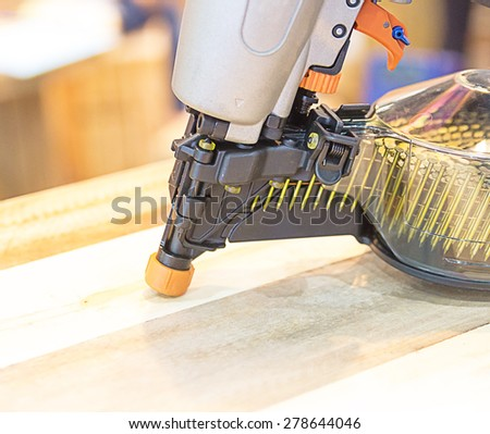 Nail gun stock images royalty free images vectors shutterstock nail gun prinsesfo Image collections