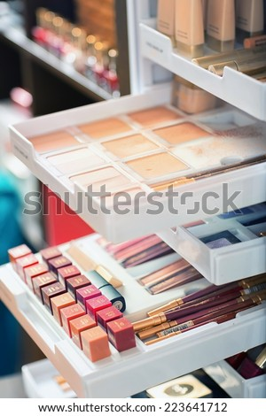 Nail polish and other beauty products on the shelf in the beauty salon - stock photo
