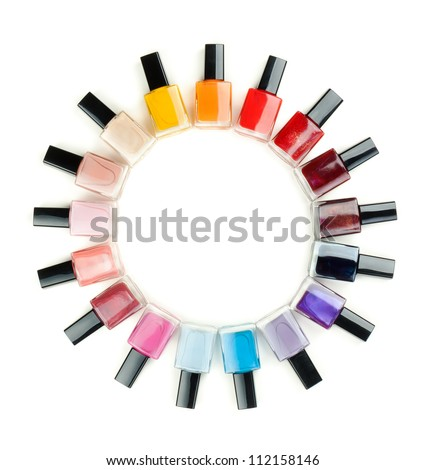 Nail polish arranged in a circle on a white background - stock photo