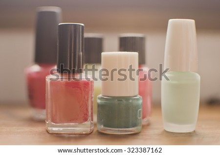 Nail polish bottles in several colors with back light - stock photo