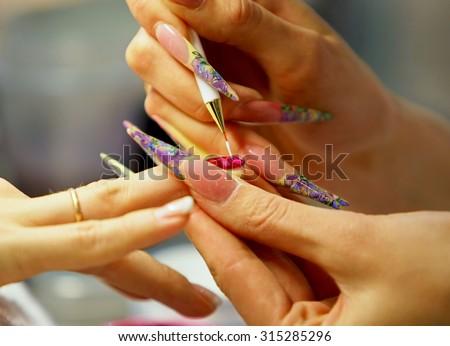 Nail polish drawing - stock photo
