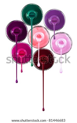 Nail polish pouring out of the bottles isolated on white - stock photo