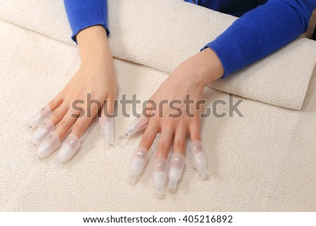 Nail polish removing in salon with special equipment