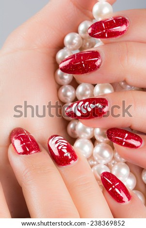nails painted with the colors of Christmas - stock photo