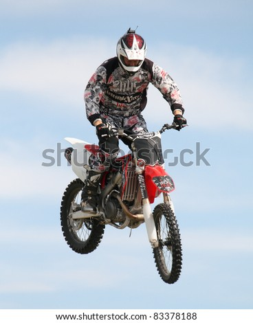 NAIRN, SCOTLAND - 30 JULY: Martin Crosswaite from the Xtreme Motor Cycle Display Team performs at the annual Nairnshire Farmers Show on 30 July 2011 in Nairn, Scotland - stock photo