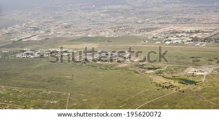 NAIROBI, KENYA - JANUARY 13: aerial view of Jomo Kenyatta International Airport on January 13, 2014 in Nairobi, Kenya. It is the ninth busiest airport in Africa with 5.8 million passengers per annum.  - stock photo