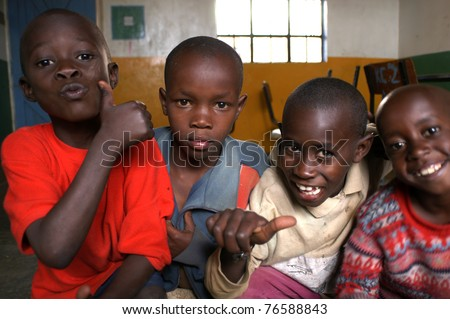 NAIROBI, KENYA - MARCH 2008: Unidentified boys in a Nairobi classroom March 2008 in Nairobi, Kenya. - stock photo