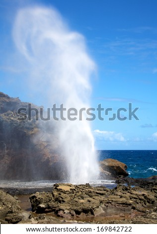Nakalele Blowhole in Maui Hawaii, produces powerful geyser-like water spouts with the waves and tides. Water spewed from the blowhole can rise as high as 100 feet in the air.  - stock photo
