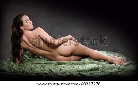 Naked beautiful woman posing on black background. Fine Art style. Great for calendar. - stock photo