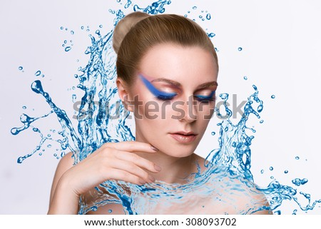 Naked beautiful woman wet from splashing water.Skin care, Cleansing and moisturizing concept. Beauty face - stock photo