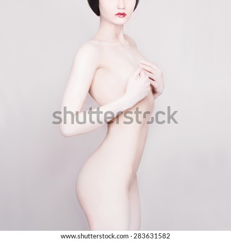 naked beautiful young woman. sexy girl.white skin.closes the chest - stock photo