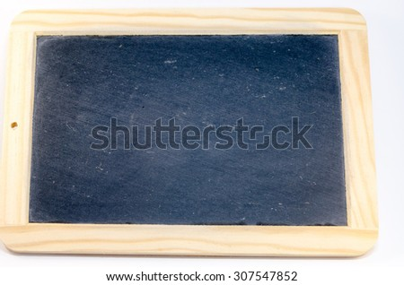 Naked black chalkboard with wooden frame against white background.