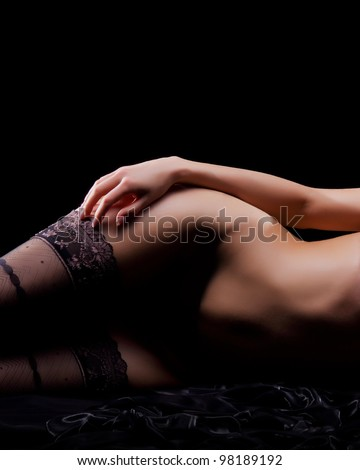 Naked body in the dark - stock photo