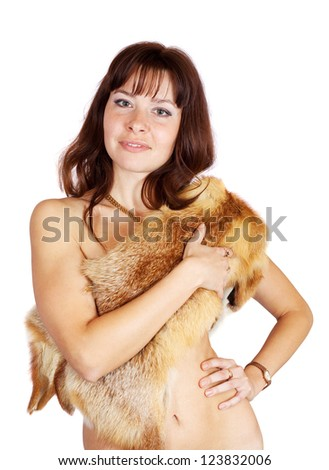 Naked girl covered fox fur over white background - stock photo