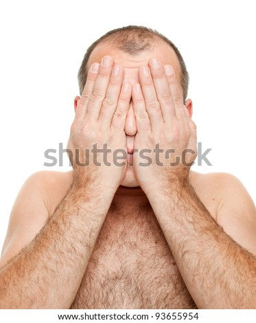 Naked man covering his face, isolated on white