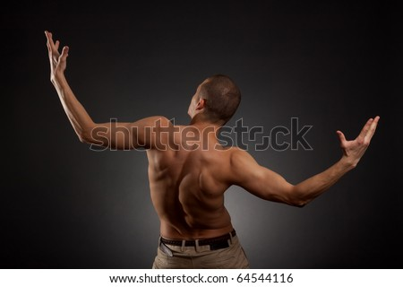 naked man rotated his back on a white background - stock photo