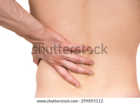 Naked man with lower back pain on white isolated background. Back view. Close-up. - stock photo