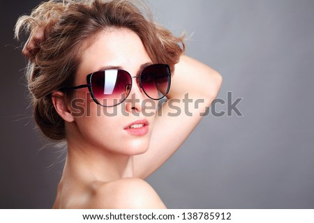 Naked sexy beautiful woman in sunglasses - stock photo