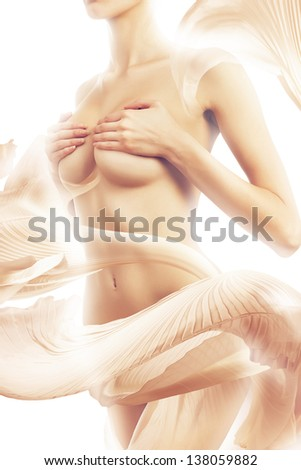 naked woman in shiny pink textile - stock photo