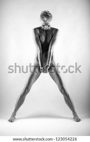 Naked woman in studio. Fine art photo of female body. - stock photo