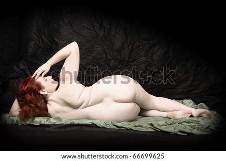 Naked woman posing on black background. Fine Art style. Great for calendar. - stock photo