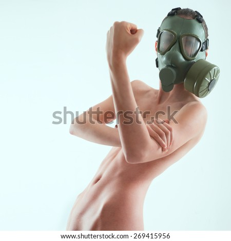 Naked woman with gas mask as fetish wear - stock photo