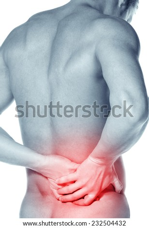 naked young man with a pain in a waist on a white background. Rear view of a young male - stock photo