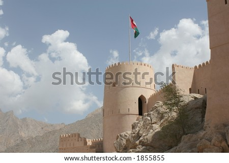 Nakhla Fort against Cloudy Sky - stock photo