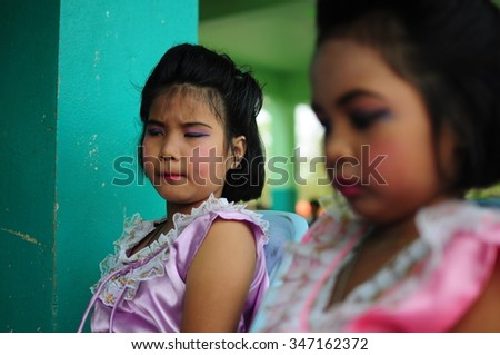 NAKHON NAYOK,THAILAND - MARCH 29 : at Wat Ploi Krachangsi School, Nakhon nayok,Thailand. Action of unidentified girl when she see the camera on MARCH 29,2012