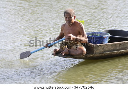 Nakhon pathom, Thailand - August 10,2013 : Disabled leg amputated are fishing for their livelihood at Maha Sawat canal.