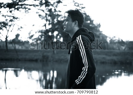 NAKHON PATHOM, THAILAND - SEPTEMBER 2, 2017:A man wear adidas sports jacket and sweatpants,  A German multinational corporation that designs and