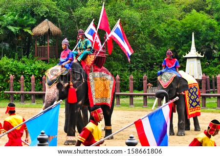 NAKHON PATHOM, THAILAND : The elephants show.Traditional combat on the back of an elephant on Octember 6, 2013 in The Rose Garden, Nakhon Pathom.