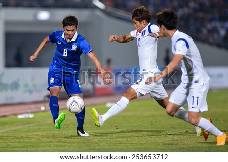NAKHON RATCHASIMA THA-Feb07:Artit Daosawang#8 of Thailand drives the ball during the 43rd King's cup match between Thailand and Korea Rep at Nakhon Ratchasima stadium on February07,2015 in Thailand. - stock photo