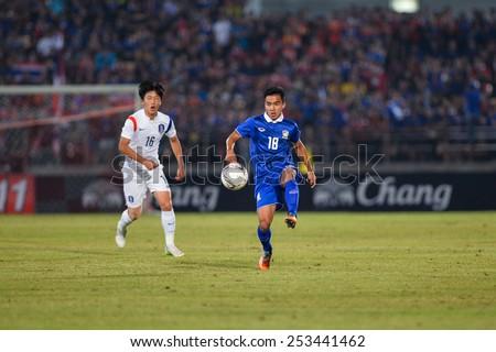 NAKHON RATCHASIMA THA-Feb7:Chanathip Songkrasin(B)of Thailand controls ball during the 43rd King's cup match between Thailand and Korea Rep at Nakhon Ratchasima stadium on February07,2015 in Thailand. - stock photo