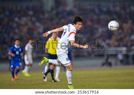 NAKHON RATCHASIMA THA-Feb07:Kim Jin-su #3 of Korea Rep for the ball during the 43rd King's cup match between Thailand and Korea Rep at Nakhon Ratchasima stadium on February07,2015 in Thailand. - stock photo