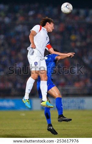 NAKHON RATCHASIMA THA-Feb07:Kim Min-hyeok #4 of Korea Rep heads the ball during the 43rd King's cup match between Thailand and Korea Rep at Nakhon Ratchasima stadium on February07,2015 in Thailand. - stock photo