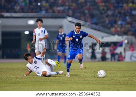 NAKHON RATCHASIMA THA-Feb07:Kroekrit Thaweekarn#4 of Thailand runs for a ball during the 43rd King's cup match between Thailand and Korea Rep at Nakhon Ratchasima stadium on February7,2015 in Thailand - stock photo