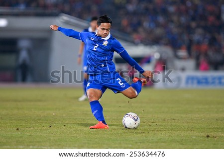 NAKHON RATCHASIMA THA-Feb07:Peerapat Notchaiya#2 of Thailand kicks a ball during the 43rd King's cup match between Thailand and Korea Rep at Nakhon Ratchasima stadium on February07,2015 in Thailand. - stock photo