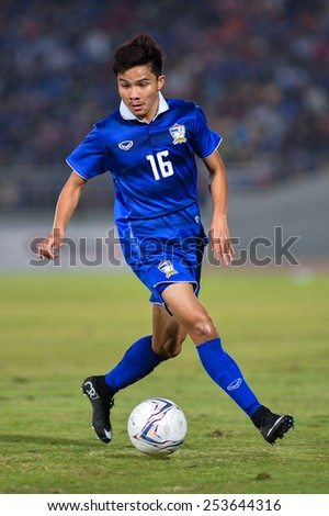 NAKHON RATCHASIMA THA-Feb07:Pinyo Inpinit#16 of Thailand run with the ball during the 43rd King's cup match between Thailand and Korea Rep at Nakhon Ratchasima stadium on February07,2015 in Thailand - stock photo