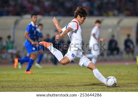 NAKHON RATCHASIMA THA-Feb07:Unidentified player of Korea Rep hit the ball during the 43rd King's cup match between Thailand and Korea Rep at Nakhon Ratchasima stadium on February07,2015 in Thailand - stock photo