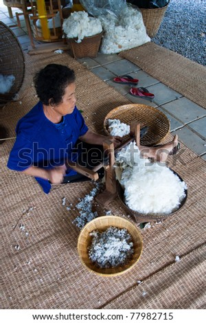 NAKHON-RATCHASIMA, THAILAND - DECEMBER 25: Traditional old style for pulling out cotton seed from cotton wool on December 25, 2008 in Nakhon-Ratchasima province, Thailand. - stock photo