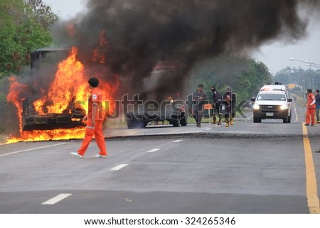 NAKHON RATCHASIMA, THAILAND â?? JANUARY 11, 2015: Fire and black smoke on the road after a tractor collision in Nakhon Ratchasima on 11 January 2015