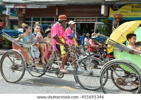 NAKHON RATCHASIMA,THAILAND-JULY 20:NAKHON RATCHASIMA CANDLE FESTIVAL 2016 People join in with candle parade go around Korat city.