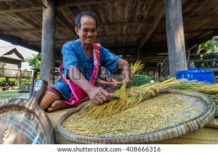 NAKHON RATCHASIMA, THAILAND - OCTOBER 31: Undefined senior villager Making shredded rice grain which is traditional thai food at Beneath of the house on October 31,2015 in Nakhon ratchasima, Thailand. - stock photo