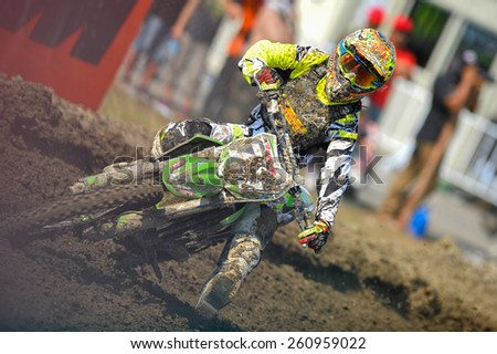 Nakhonchaisri,THAI-MAR 08:MXGP riders race during the competes during the Thai MXGP World Championship at thailand Circuit on March08,2015 in Nakhonpathom,Thailand - stock photo